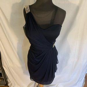 Xscape one shoulder rhinestone embellished dress.